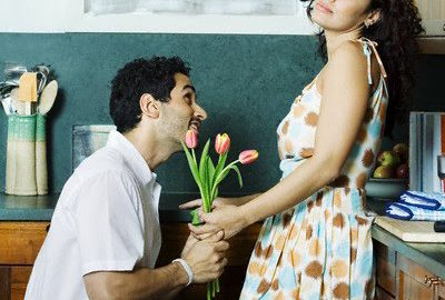 Woman Receiving Flowers --- Image by © Royalty-Free/Corbis