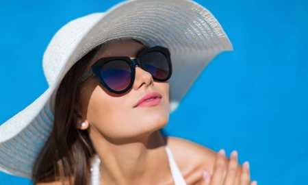 woman-wearing-sunglasses-and-hat-su