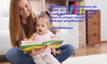 Mother showing images in book to her cute little girl