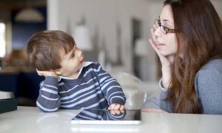 Small boy talking to his mother