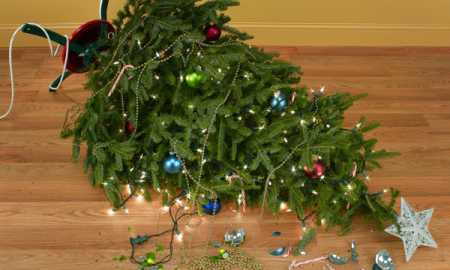 Toppled over Christmas tree with decorations and lights