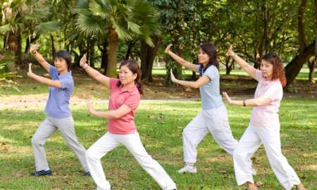 group-of-women-performing-tai-chi-on-grass